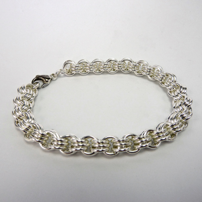 Goudsmid Edelsmid Ylva Roël. Design sieraden, ontwerp laten maken Haarlem. armband, zilver, '3in3' Ø 7mm Zilveren viking sieraden. A158